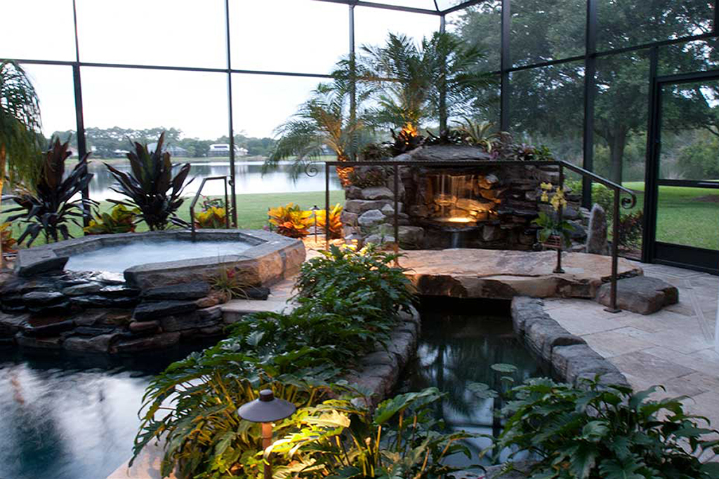 Swimming pool remodel with grotto spa bridge and koi for Koi pond and swimming pool
