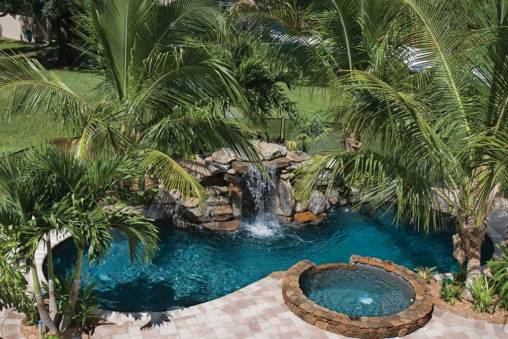 small lagoon pool with spa and waterfall by lucas lagoons inc. Black Bedroom Furniture Sets. Home Design Ideas