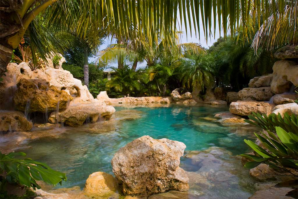 Natural Lagoon swimming pool with sand bottom and waterfalls