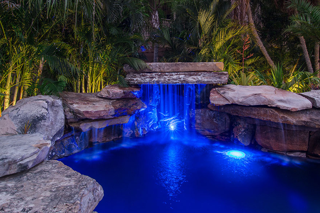 Lucas lagoons pool and koi pond as seen on insane pools for Koi swimming pool