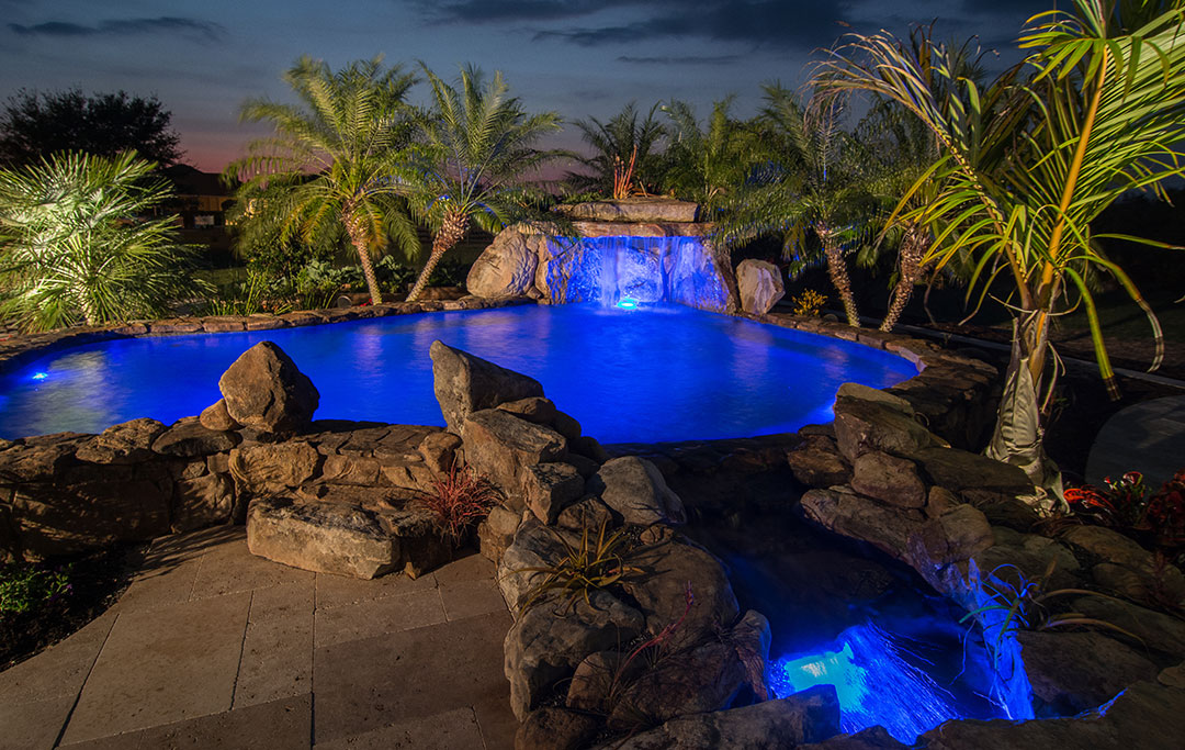 Heated pools with swim jets, grottos and stream with bridge